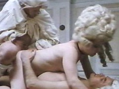 Staggering costumed beauties with bushy vaginas are getting ramrods in all of their holes in this great vintage porn video.
