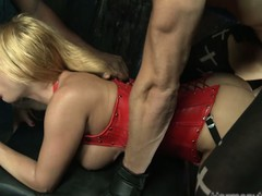 Curvy blond thrall in a red-hot corset receives pounded raw in a dungeon