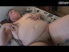 Chubby granny masturbating near lengthy dark fake penis
