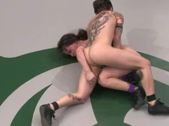 Tattooed wrestler receives over their way opponent and permeates their way hard