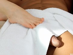 Sneaky tolerant gives a stud a footjob when this guy isn't looking