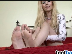 Blonde Shows Off Her Arms And Soles